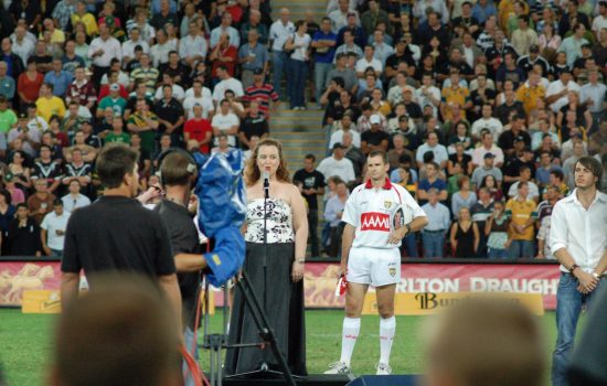 D'Arne singing National Anthem at Rugby League